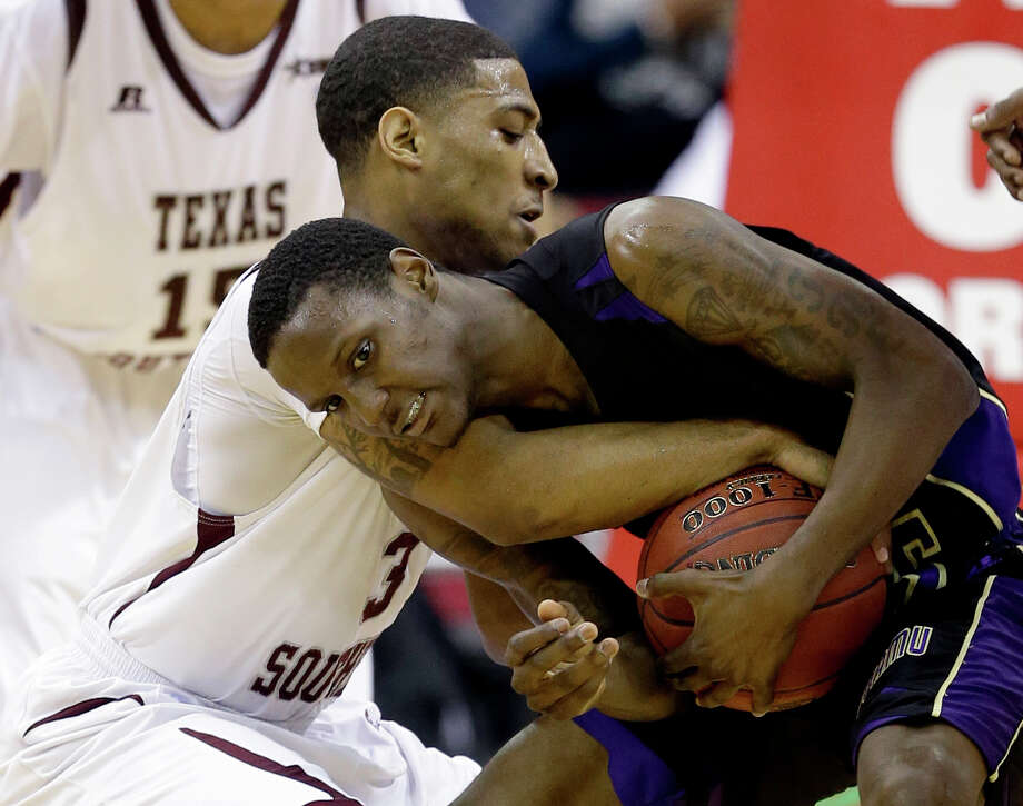 Texas Southern's Madarious Gibbs (3) forces a jump ball call with Prairie View A&M's Tre Hagood during the first half of an NCAA college basketball game in the championship of the Southwestern Athletic Conference tournament Saturday, March 15, 2014, in Houston. (AP Photo/David J. Phillip) Photo: David J. Phillip, Associated Press / AP