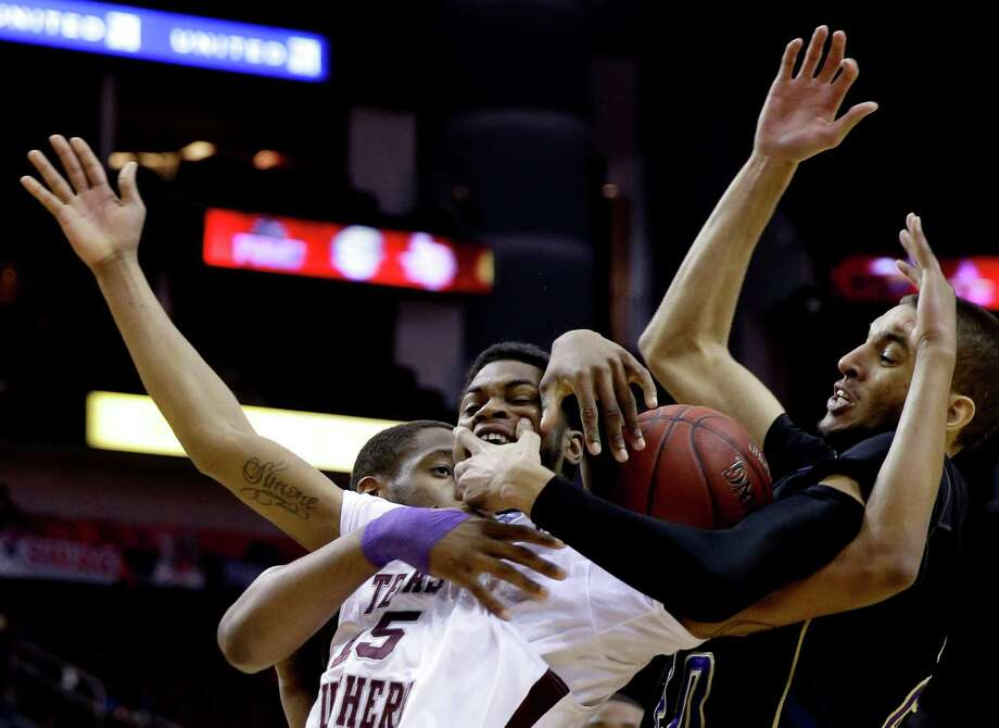Texas Southern's D'Angelo Scott (15) is wrapped up by Prairie View A&M's Jules Montgomery, right, and Reggis Onwukamuche, left, during the first half of an NCAA college basketball game in the championship of the Southwestern Athletic Conference tournament Saturday, March 15, 2014, in Houston. (AP Photo/David J. Phillip) Photo: David J. Phillip, Associated Press / AP
