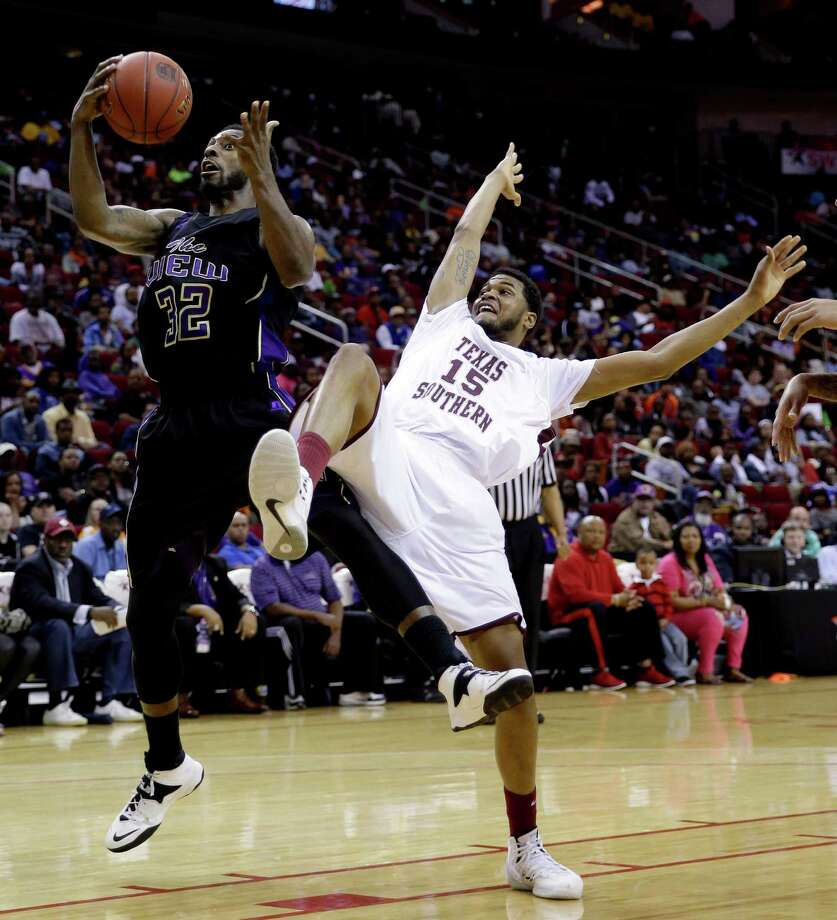 Texas Southern's D'Angelo Scott (15) falls backward while reaching for a rebound with Prairie View A&M's Demondre Chapman (32) during the first half of an NCAA college basketball game in the championship of the Southwestern Athletic Conference tournament Saturday, March 15, 2014, in Houston. (AP Photo/David J. Phillip) Photo: David J. Phillip, Associated Press / AP