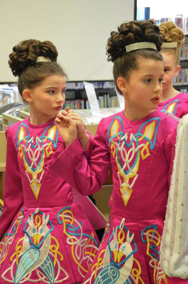 Clodagh Walsh, left, and Erin McHugh, both 10 and from Fairfield, prepare to perform traditional dances Saturday at the Pequot Library. Photo: Jarret Liotta / Fairfield Citizen