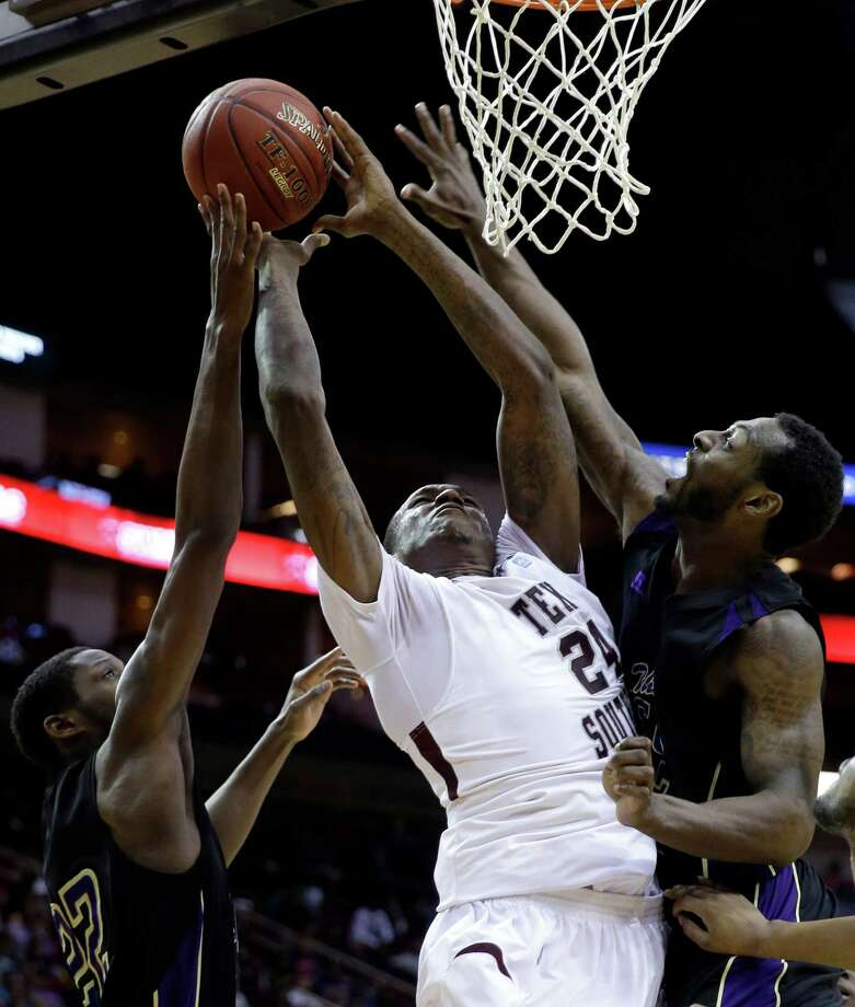 Texas Southern's Aaric Murray (24) goes up for a shot as Prairie View A&M's Rasi Jenkins (22) and Demondre Chapman, right, defend during the first half of an NCAA college basketball game in the championship of the Southwestern Athletic Conference tournament Saturday, March 15, 2014, in Houston. (AP Photo/David J. Phillip) Photo: David J. Phillip, Associated Press / AP