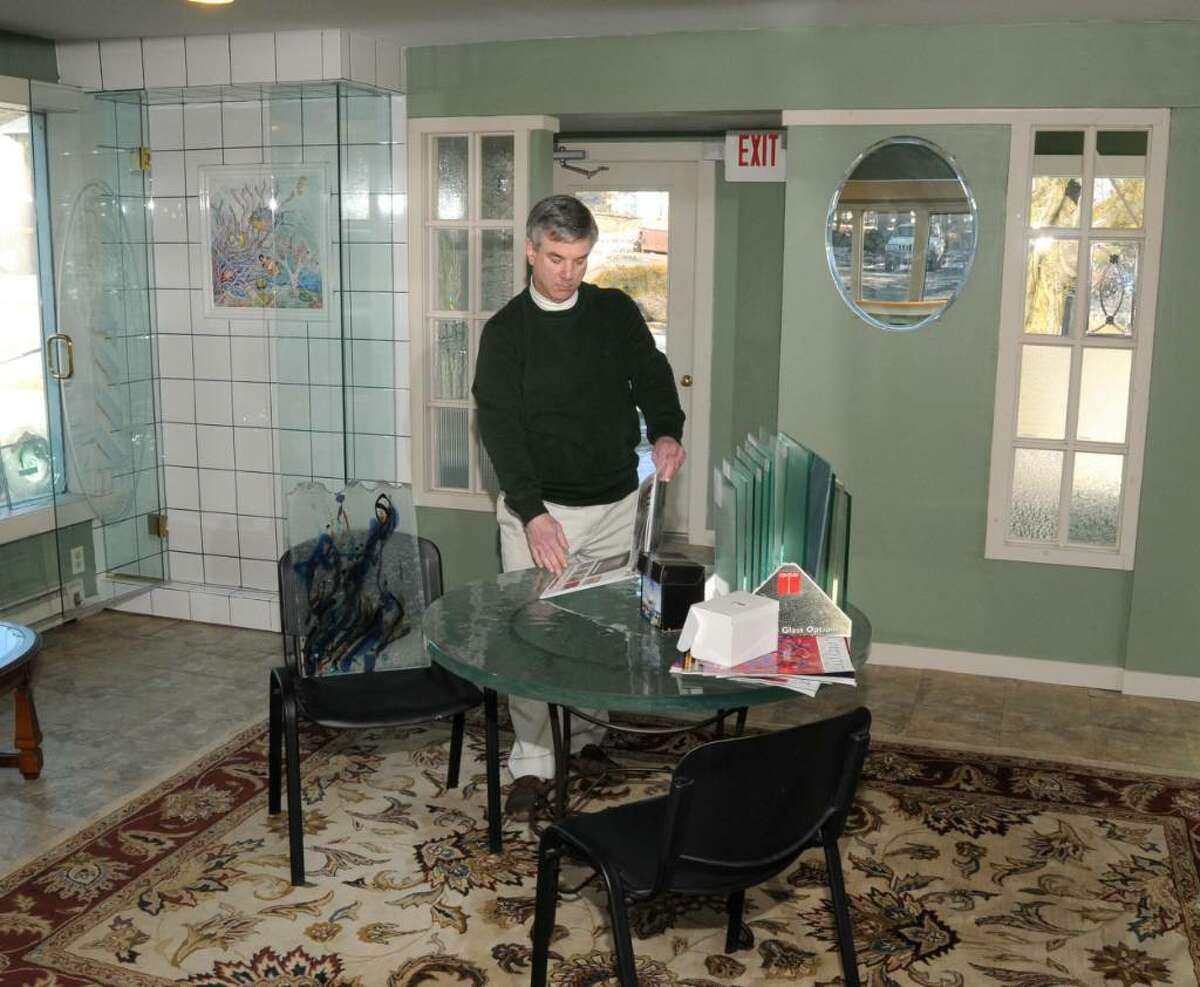 John Petchonka, co-owner of Ridgefield Glass, in the company's showroom at 4 Danbury Rd., Ridgefield, CT, on Tuesday, Feb.9, 2010