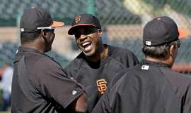 San Francisco Giants former player Barry Bonds watches batting practice before a spring training baseball game in Scottsdale, Ariz., Monday, March 10, 2014. Bonds starts a seven day coaching stint Monday. (AP Photo/Chris Carlson)