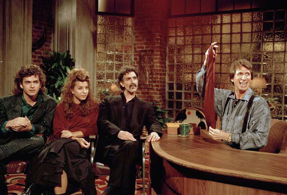 Comedian David Brenner hosts musician Frank Zappa (center) and Zappa's children Dweezil (left) and Moon Unit in 1986 on the talk show he hosted. Photo: David Bookstaver, Associated Press