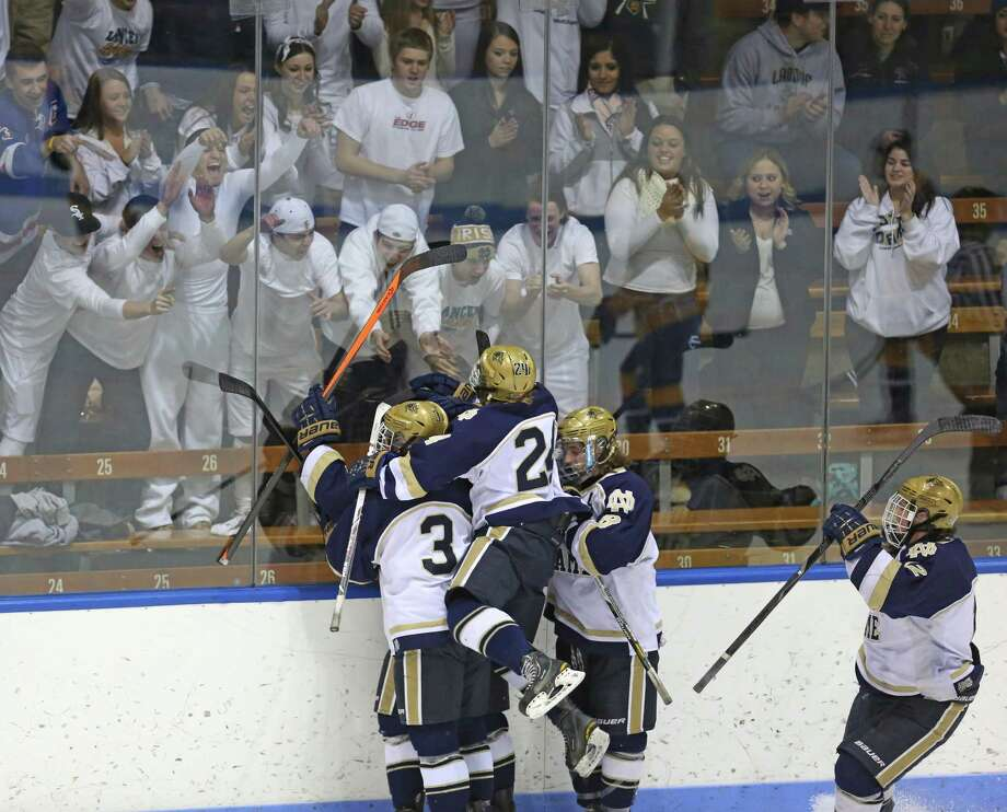 Notre Dame of Fairfield players celebrate after teammate and Captain Christian La Croix scores a goal over East Haven High School during Saturday evening CIAC State Tournament at Ingallis Rink in New Haven. Photo: Mike Ross / Mike Ross Connecticut Post freelance -www.mikerossphoto.com