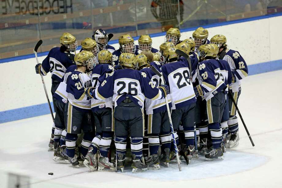 Notre Dame of Fairfield plyaers hudle at the start of Saturday evening's  CIAC quarterfinals against East Haven High School. Photo: Mike Ross / Mike Ross Connecticut Post freelance -www.mikerossphoto.com