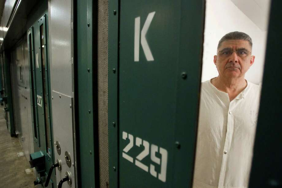 Rogelio Baca stands in his cell in the administrative segregation wing of the Estelle Unit in Huntsville. In the last six years, Texas has reduced by 25 percent the number of inmates in solitary. Photo: Brett Coomer, Staff / © 2014 Houston Chronicle