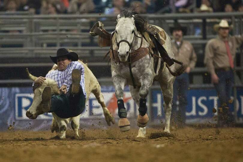 Olin Hannum competes in the BP Super Series IV Championship Round Steer Wrestling competition during