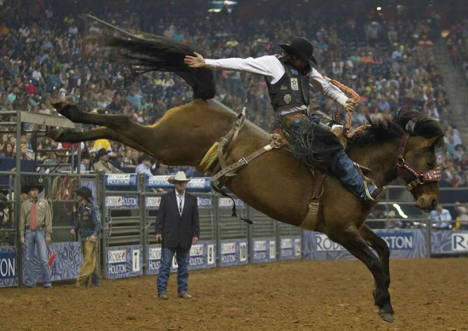 Sam Spreadborough competes in the BP Super Series IV Championship Round Saddle Bronc Riding competition during the Houston Livestock Show and Rodeo, Saturday, March 15, 2014, in Houston. Photo: Marie D. De Jesús, Houston Chronicle / © 2014 Houston Chronicle
