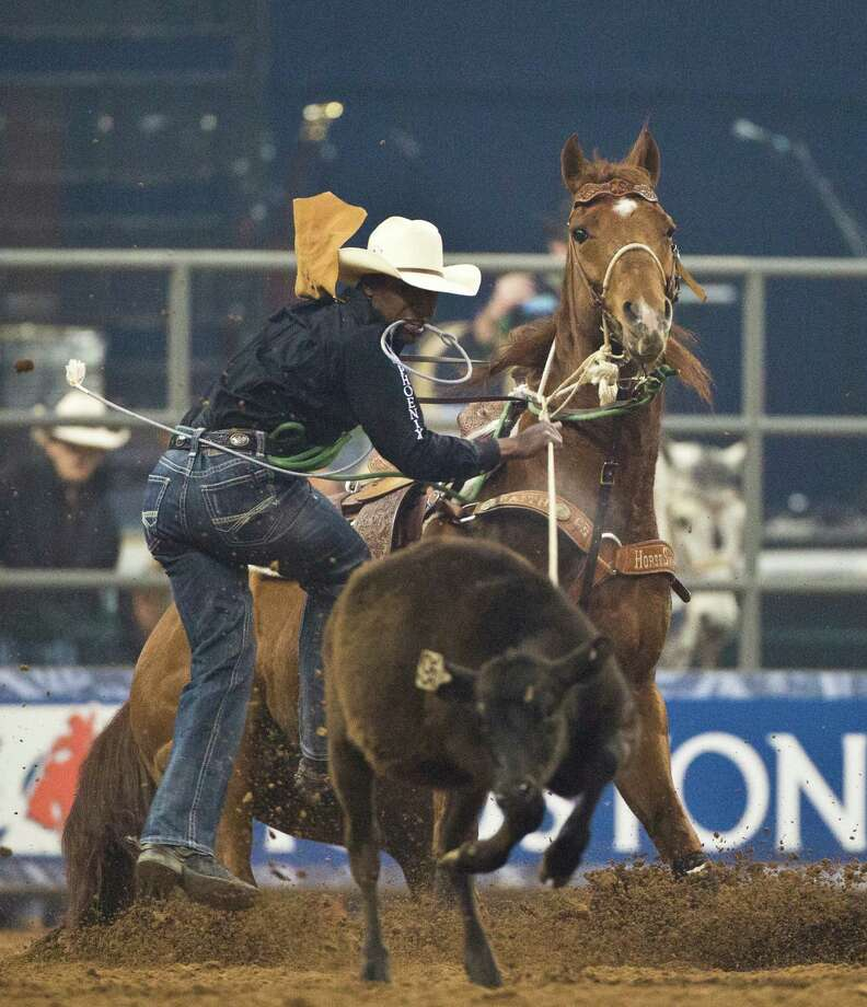 Cory Solomon competes in the BP Super Series IV Championship Round Tie-Down Roping competition at Reliant Stadium on Saturday, March, 15 2014, during the Houston Livestock Show and Rodeo. Photo: Marie D. De Jesús, Houston Chronicle / © 2014 Houston Chronicle