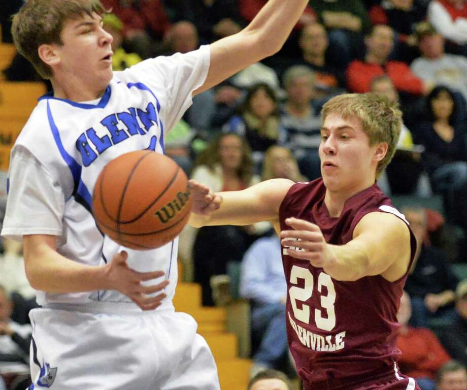 Scotia-Glenville's #23 Alex Sausville, right, fires a pass by John Glenn's #20 Timmy Grescher during the  Class A boys' semifinal Saturday March 15, 2014, in Glens Falls, NY.  (John Carl D'Annibale / Times Union) Photo: John Carl D'Annibale / 00026138A