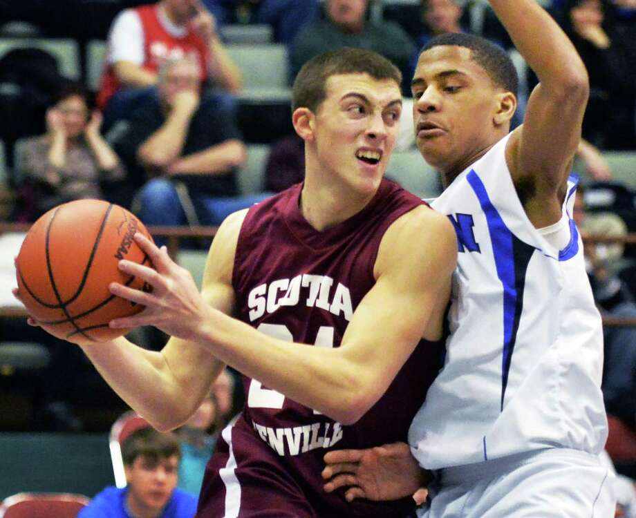 Scotia's #24 Joe Cremo, left, and John Glenn's #1 Darryl Daniels battle during the Class A boys' semifinal Saturday March 15, 2014, in Glens Falls, NY.  (John Carl D'Annibale / Times Union) Photo: John Carl D'Annibale / 00026138A