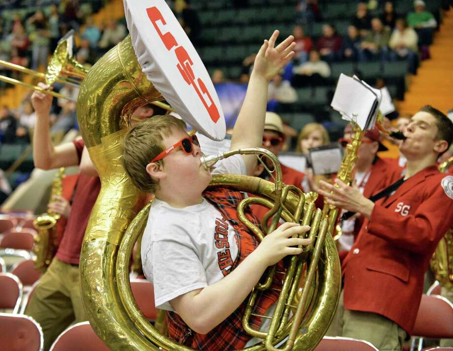 Sousaphone player Kyle Yagielski leads the Scotia pep band during their semifinal game against John Glenn March 15, 2014, in Glens Falls, NY.  (John Carl D'Annibale / Times Union) Photo: John Carl D'Annibale / 00026138A