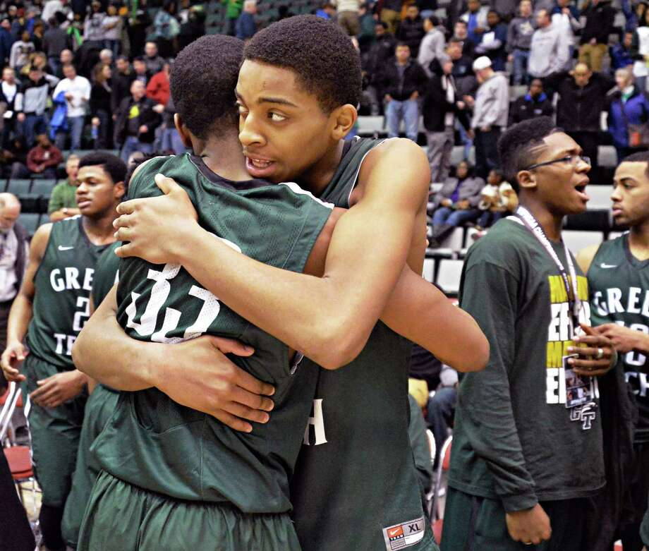 Green Tech's #33 Anquan McClean and #5 David Clark celebrate after the win against Brentwood in the Class AA boys' basketball semifinal Saturday March 15, 2014, in Glens Falls, NY.  (John Carl D'Annibale / Times Union) Photo: John Carl D'Annibale / 00026139A