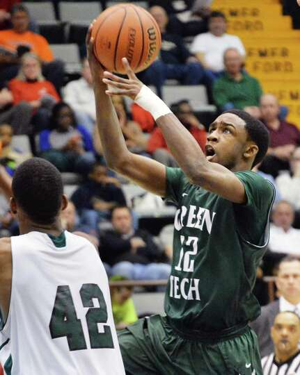 Green Tech's #12 Jamil Hood, Jr.,, right, shoots against Brentwood in the Class AA boys' basketball