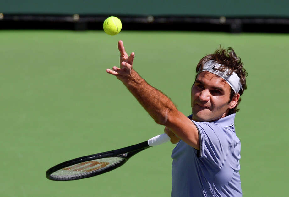 Roger Federer, of Switzerland, serves to Alexandr Dolgopolov, of Ukraine, during their semifinal match at the BNP Paribas Open tennis tournament, Saturday, March 15, 2014, in Indian Wells, Calif. (AP Photo/Mark J. Terrill) ORG XMIT: IWT211 Photo: Mark J. Terrill / AP