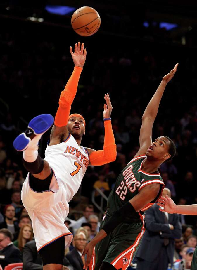 New York Knicks' Carmelo Anthony shoots the ball up against Milwaukee Bucks' Khris Middleton in the first quarter of an NBA basketball game at New York's Madison Square Garden, Saturday, March 15, 2014. (AP Photo/Richard Drew) ORG XMIT: NYRD101 Photo: Richard Drew / AP