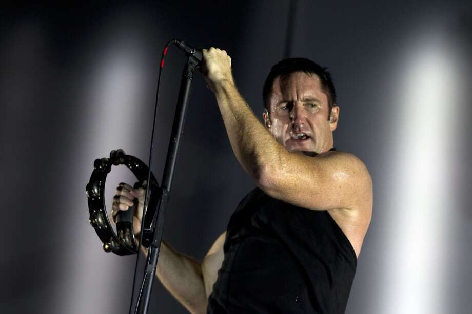 The Nine Inch Nails band performs on the first day of the Lowlands festival in Biddinghuizen, the Netherlands, on August 16, 2013.  AFP PHOTO / ANP / KIPPA PAUL BERGEN  ***Netherlands out***PAUL BERGEN/AFP/Getty Images Photo: AFP/Getty Images