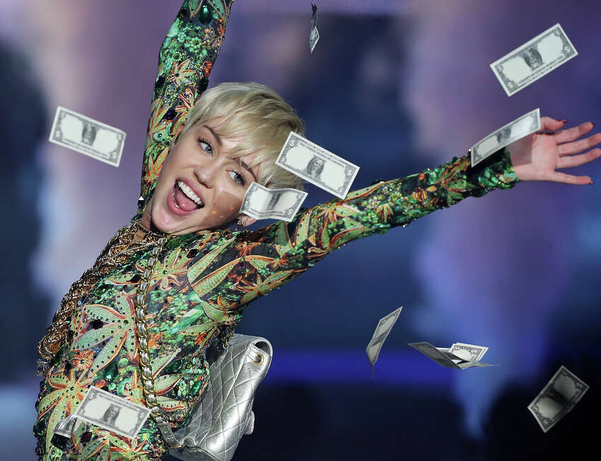 Miley Cyrus performs Saturday March 15, 2014 at the AT&T Center.