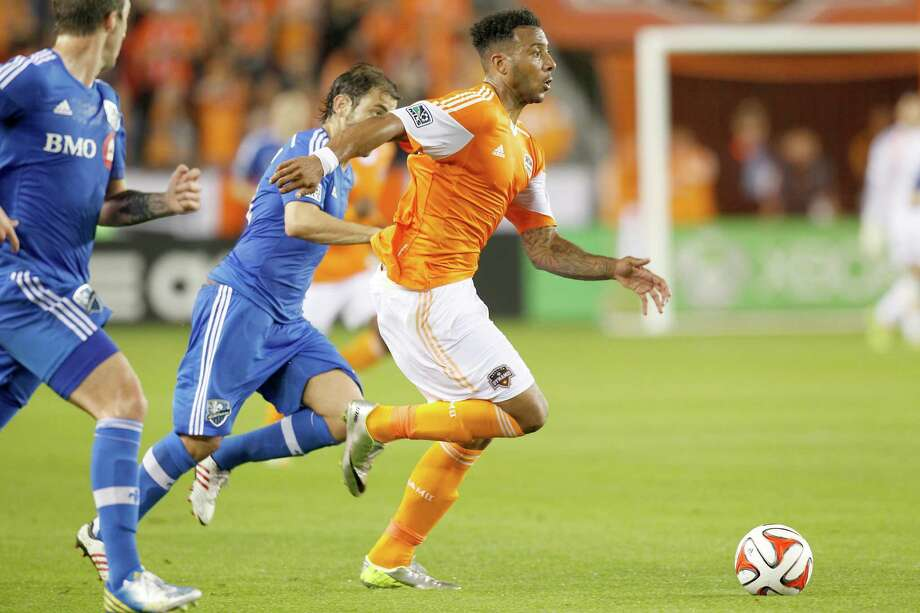 3/15/14: Houston Dynamo midfielder Giles Barnes (23) splits the Montreal Impact defender in the first half at BBVA Compass Stadium in Houston, Texas. Photo: Thomas B. Shea, For The Chronicle / © 2014 Thomas B. Shea