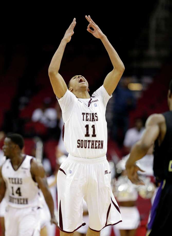 Texas Southern's Lawrence Johnson-Danner raises his arms as he celebrates making a three-point basket against Prairie View A&M during the second half of an NCAA college basketball game in the championship of the Southwestern Athletic Conference tournament Saturday, March 15, 2014, in Houston. Texas Southern won 78-73. (AP Photo/David J. Phillip) Photo: David J. Phillip, Associated Press / AP