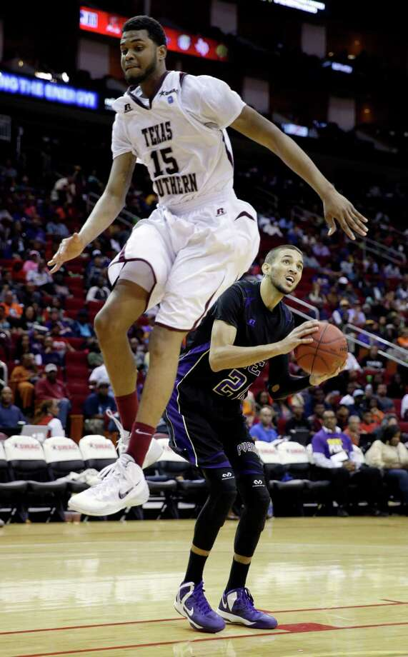 Prairie View A&M's Jules Montgomery (20) waits for Texas Southern's D'Angelo Scott (15) to jump past before shooting during the second half of an NCAA college basketball game in the championship of the Southwestern Athletic Conference tournament Saturday, March 15, 2014, in Houston. Texas Southern won 78-73. (AP Photo/David J. Phillip) Photo: David J. Phillip, Associated Press / AP