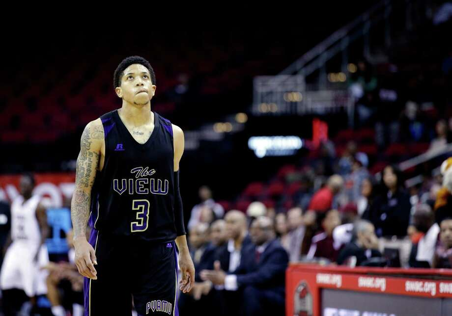 Prairie View A&M's Louis Munks (3) looks up at the scoreboard as he walks toward his bench during the closing minutes of the second half of an NCAA college basketball game against Texas Southern in the championship of the Southwestern Athletic Conference tournament Saturday, March 15, 2014, in Houston. Texas Southern won 78-73. (AP Photo/David J. Phillip) Photo: David J. Phillip, Associated Press / AP