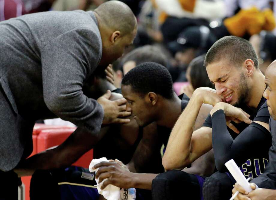 Prairie View A&M's Jules Montgomery, right, cries as coach Byron Rimm II, left, comforts another player during the closing minutes of the second half of an NCAA college basketball game against Texas Southern in the championship of the Southwestern Athletic Conference tournament Saturday, March 15, 2014, in Houston. Texas Southern won 78-73. (AP Photo/David J. Phillip) Photo: David J. Phillip, Associated Press / AP