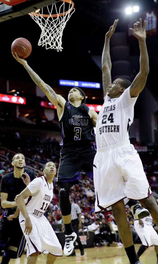 Texas Southern's Aaric Murray (24) goes up to block the shot of Prairie View A&M's Louis Munks (3) during the second half of an NCAA college basketball game in the championship of the Southwestern Athletic Conference tournament Saturday, March 15, 2014, in Houston. Texas Southern won 78-73. (AP Photo/David J. Phillip) Photo: David J. Phillip, Associated Press / AP