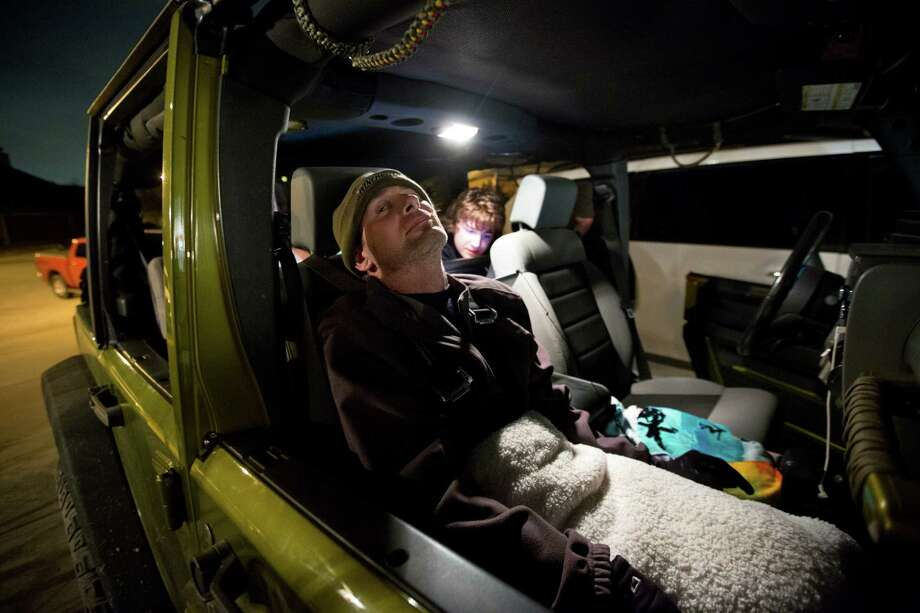 Captain Bill Dowling sits back for a family evening drive in his Jeep around Tomball, Friday, March 14, 2014. Photo: Marie D. De Jesus, Houston Chronicle / © 2014 Houston Chronicle