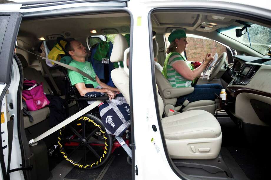 Captain Bill Dowling, left, is all ready and buckled up for the drive from Tomball to Houston to participate on the 2014 St. Patrick's Parade with his wife Jacki Dowling, right, and children. Saturday, March 15, 2014, in Tomball. Dowling is the 55th Annual Houston St. Patrick's Parade grand marshal. Photo: Marie D. De Jesus, Houston Chronicle / © 2014 Houston Chronicle