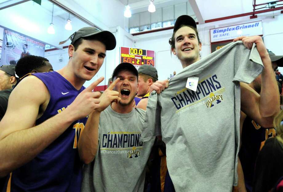 Albany players celebrate their 69-60 win over Stony Brook in an NCAA college basketball game in the championship of the America East Conference tournament Saturday, March 15, 2014, in Stony Brook, N.Y. (AP Photo/Kathy Kmonicek) ORG XMIT: NYKK114 Photo: Kathy Kmonicek / FR170189 AP