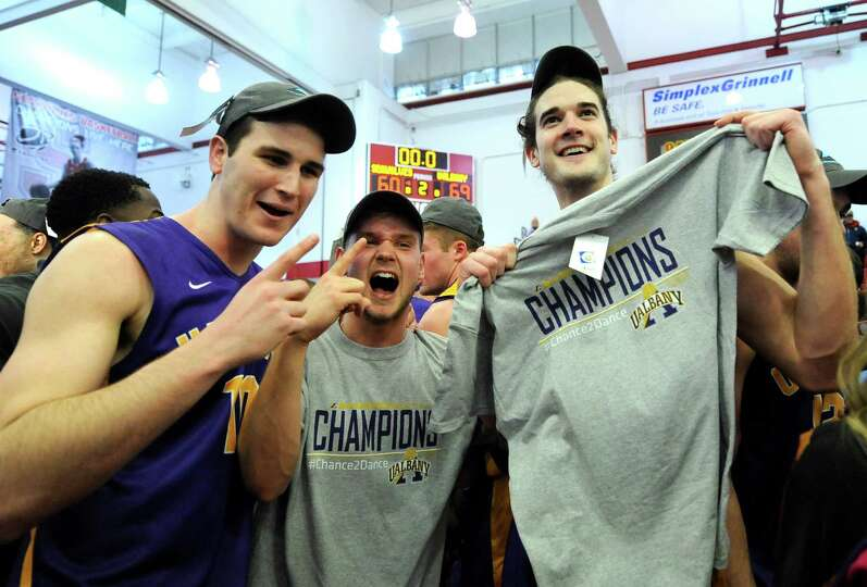 Albany players celebrate their 69-60 win over Stony Brook in an NCAA college basketball game in the