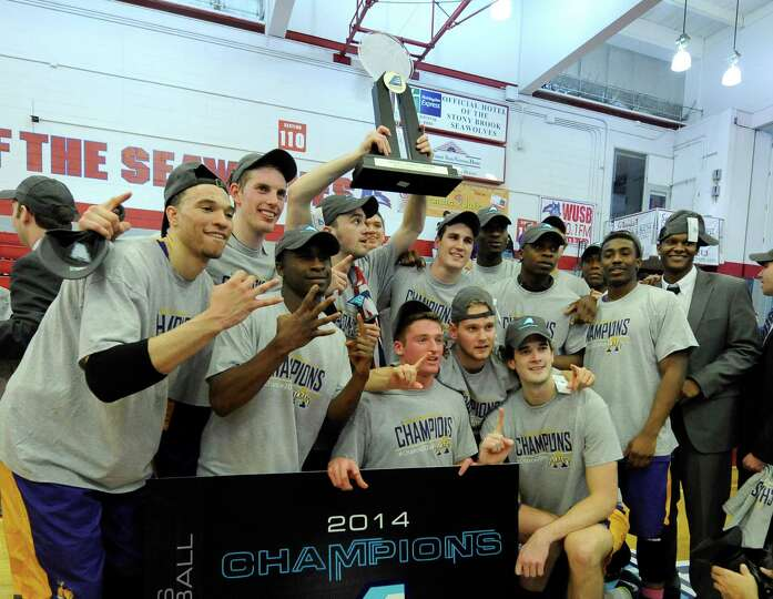 Albany celebrates their 69-60 win over Stony Brook in an NCAA college basketball game in the champio