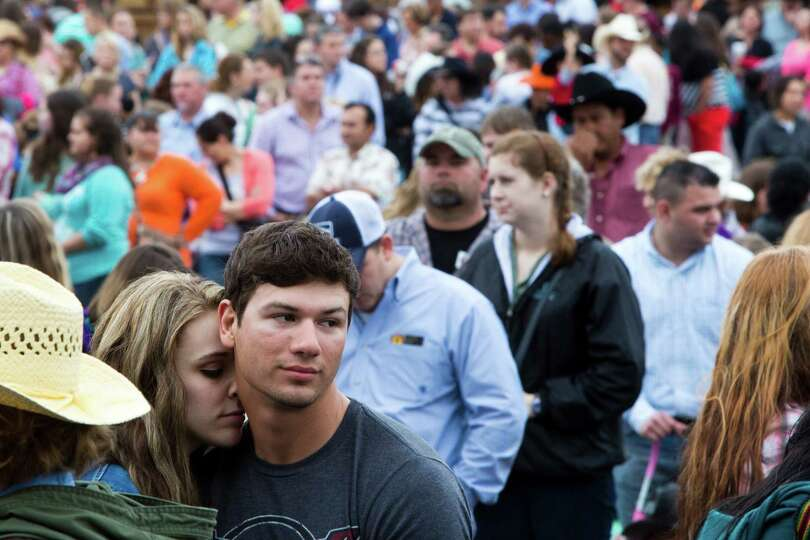 Chris Beck, 21, and Alex Kozuch, left, 21, share a moment while waiting in line to enter Reliant Sta