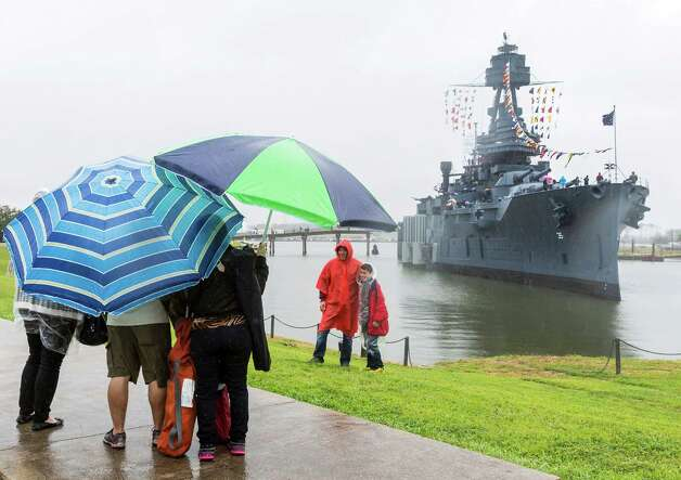 Despite the driving rain, thousands pay tribute to the Battleship Texas on its 100th anniversary. Photo: Craig Hartley, For The Chronicle / Copyright: C