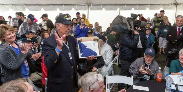 Veteran Orlan Scott, age 86, says a few words to the crowd in appreciation of the flag he received on his birthday. Photo: Craig Hartley, For The Chronicle / Copyright: Craig H. Hartley