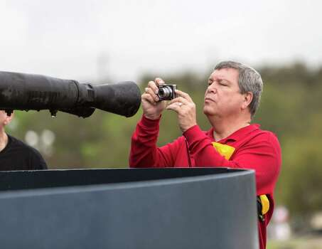 Terry Williams gets an up close and personal photo of the twin 40mm BOFORS anti-aircraft guns. Photo: Craig Hartley, For The Chronicle / Copyright: Craig H. Hartley