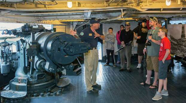 """Park Volunteer Stan Adams explains the operation and use of the 5"""" guns bristling from the sides of the Battleship Texas. Photo: Craig Hartley, For The Chronicle / Copyright: Craig H. Hartley"""