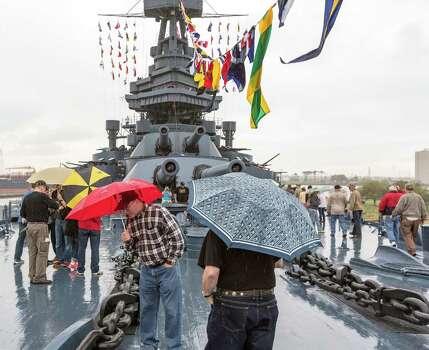 "Despite the rain, thousands tour the Battleship Texas with its massive 14""/45 caliber naval rifles. Photo: Craig Hartley, For The Chronicle / Copyright: Craig H. Hartley"