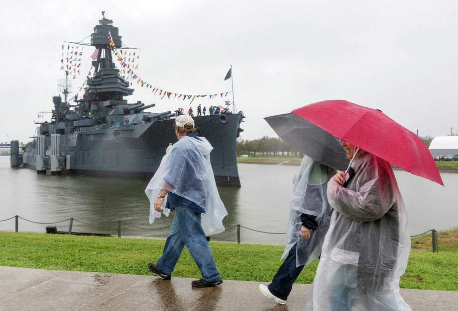 Despite the driving rain, thousands pay tribute to the Battleship Texas on its 100th anniversary. Photo: Craig Hartley, For The Chronicle / Copyright: Craig H. Hartley