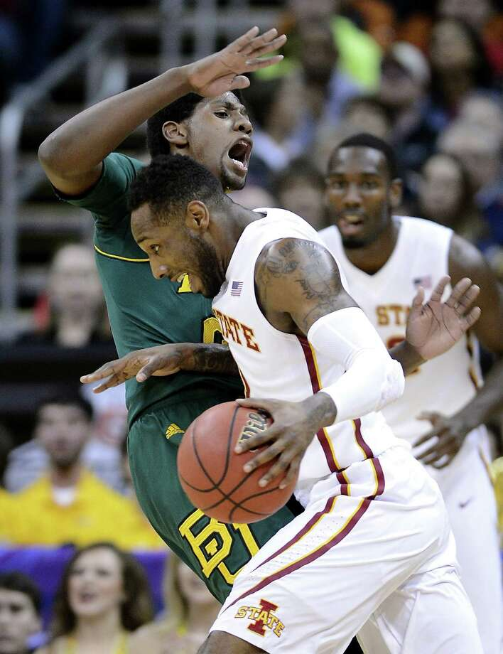 Iowa State's DeAndre Kane lowers the boom on Baylor's Royce O'Neale, left, in the first half. Photo: Rich Sugg, MBR / Kansas City Star