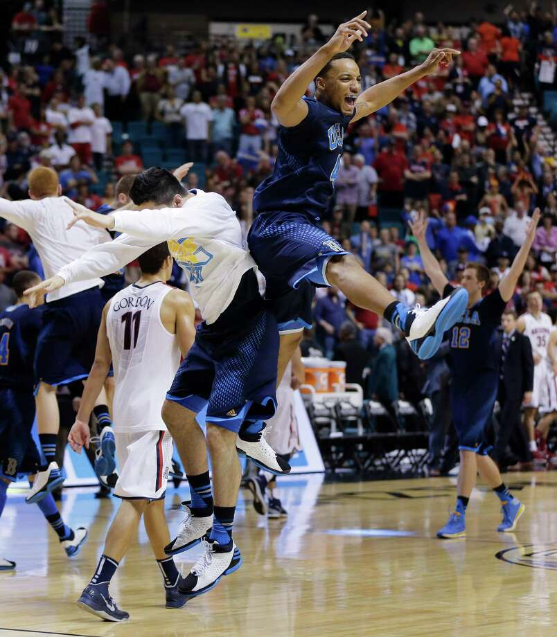 Norman Powell, right, rises to the occasion after UCLA beat No. 4 Arizona in the Pac-12 title game. Photo: Julie Jacobson, STF / AP