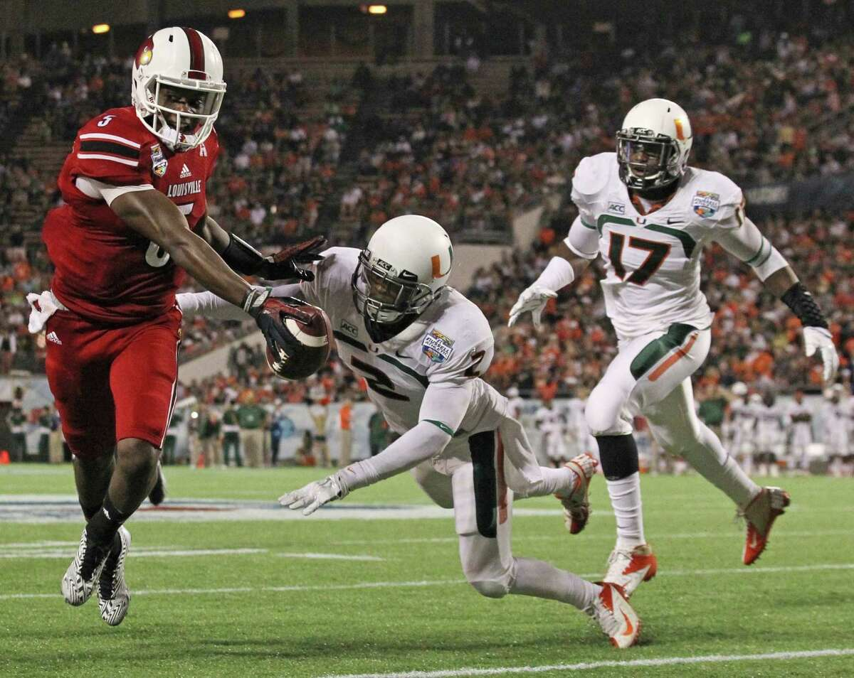 According to his former coaches, Louisville quarterback Teddy Bridgewater, left, has more than enough speed to succeed at the professional level.