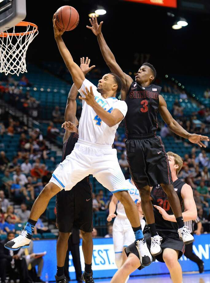 UCLA's Norman Powell gets past Stanford's Malcolm Allen for a layup in a Pac-12 semifinal. Photo: Ethan Miller, Getty Images