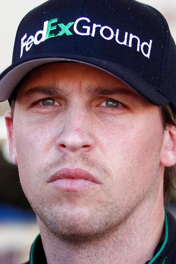 Denny Hamlin suffered a broken vertebra in a crash with ex-teammate Joey Logano a year ago. / 2014 Getty Images