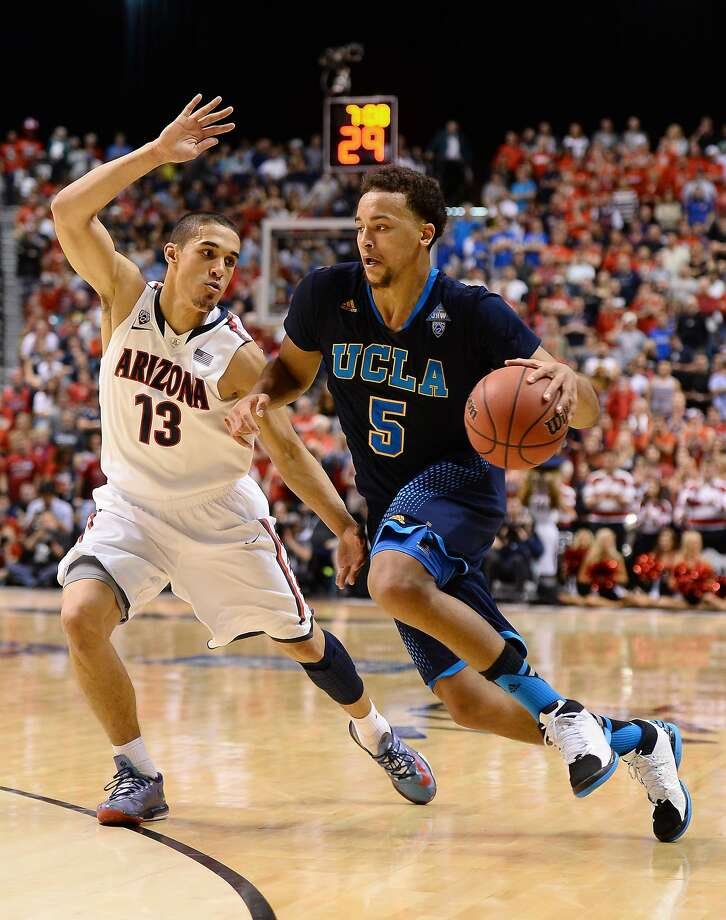 UCLA's Kyle Anderson is on the move against Arizona's Nick Johnson in the Pac-12 championship game. Photo: Ethan Miller, Getty Images