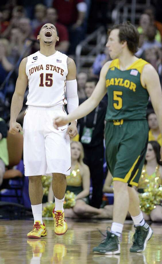 Iowa State guard Naz Long can't contain his excitement in the closing seconds of the Big 12 tournament championship as Baylor guard Brady Heslip looks on. Photo: Rich Sugg / McClatchy-Tribune News Service / Kansas City Star
