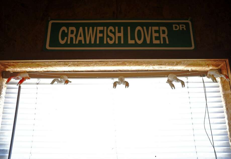 The walls of JuJu's Cajun Crawfish in Fannett are decorated with humorous and handwritten signs. JuJu's serves up nothing but crawfish, corn on the cob, and potatoes during the mudbug season. The small, family-owned restaurant is in its 12th year. Photo taken Thursday, 2/27/14 Jake Daniels/@JakeD_in_SETX