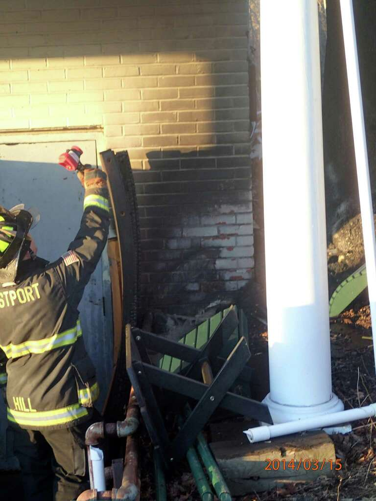 Firefighters At The Scene Of A Fire That Burned Outside The Patio.com Store  On